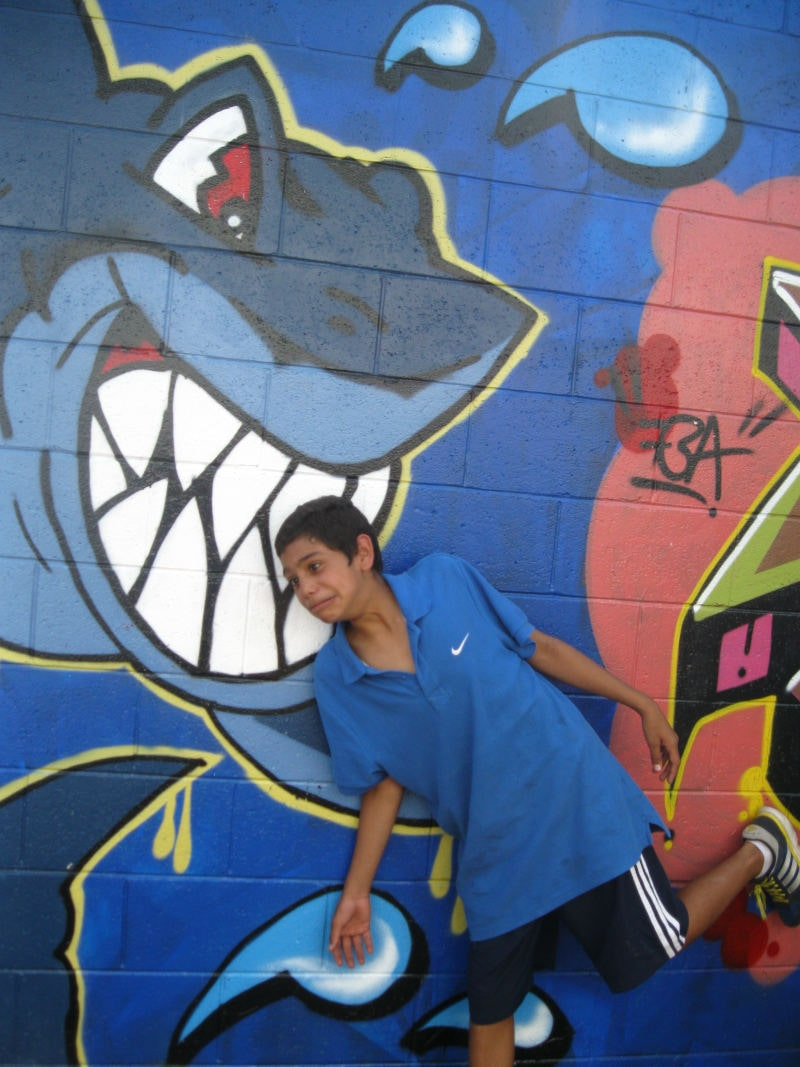 Posing with graffiti in background